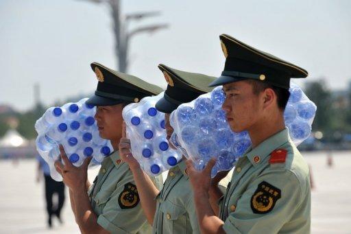 Beijing halts sales of tainted bottled water